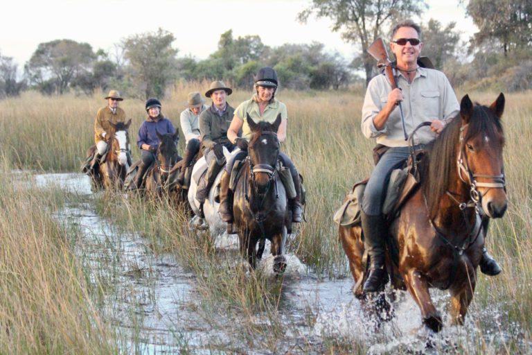 David Foot Safaris group gallop through the flood waters