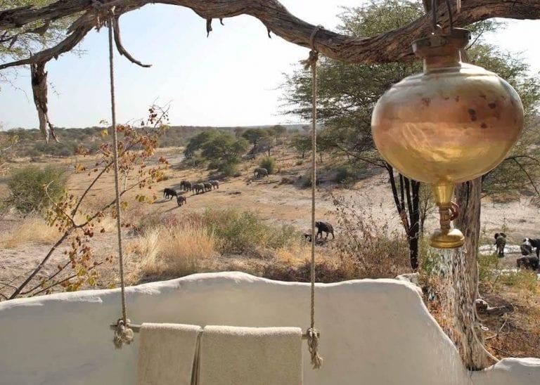 Elephant crossing the river bed at Meno a Kwena