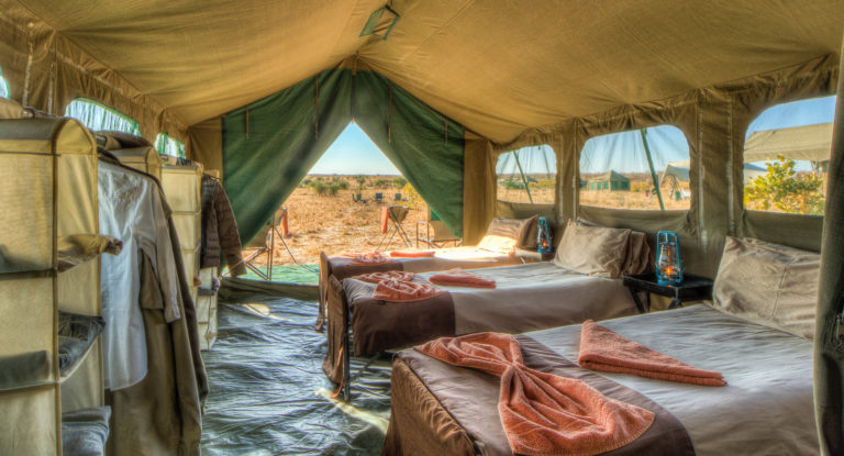 Pride of Africa standard mobile camp with view of the plains