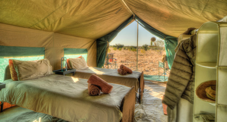 Pride of Africa's standard mobile tents contain ensuite bucket shower and toilet