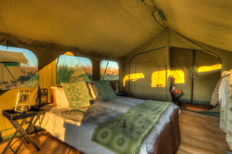 Pride of Africa's luxury meru tents have twin beds and hanging cupboards