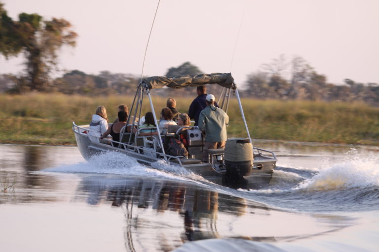 Boat safari departs camp with Endeavour Safaris guests onboard