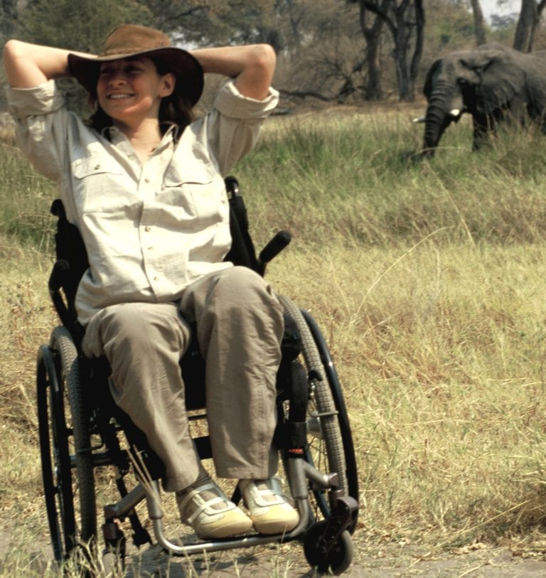 A guest with Endeavour Safaris enjoying watching elephant on safari